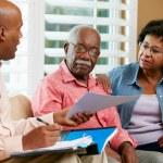 Financial Advisor Talking To Senior Couple At Home — Stock Photo