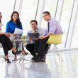 Businesspeople Having Meeting Around Table In Modern Office — Stock Photo