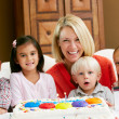 Mother Celebrating Child's Birthday With Friends — Stock Photo #24645993
