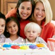 Stock Photo: Mothers Celebrating Child's Birthday With Friends