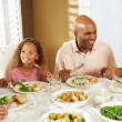 Stock Photo: Family Enjoying Meal At Home
