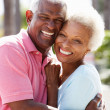 Romantic Senior Couple Hugging In  Street - Stockfoto