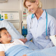 Doctor Visiting Child Patient On Ward — Stock Photo #24646647