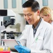 Male Scientist Using Tablet Computer In Laboratory — Stock Photo