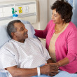 Senior Wife Visiting Husband On Ward — Foto Stock