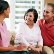 Nurse Making Notes During Home Visit With Senior Couple — Stock Photo