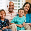 Stock Photo: Portrait Of Family Sitting On SofTogether