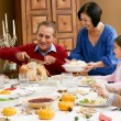 Multi Generation Family Celebrating With Christmas Meal — Stock Photo #24647111