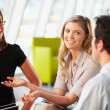Businesspeople Having Meeting Around Table In Modern Office — Stockfoto #24647493
