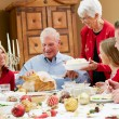 Multi Generation Family Celebrating With Christmas Meal — Stock Photo #24647601