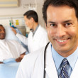 Royalty-Free Stock Photo: Portrait Of Doctor With Patient In Background
