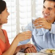 Stock Photo: Couple Enjoying Meal At Home