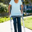 Stock Photo: Senior WomWith Walking Frame