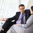 Businesspeople Sitting On Sofa In Modern Office — Stock Photo
