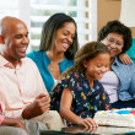 Multi Generation Family Celebrating Daughter's Birthday — Stock Photo