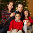 Family In Front Of Christmas Tree — Foto de Stock
