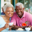 Stock Photo: Senior WomEnjoying Snack At Outdoor Cafe
