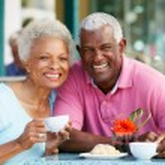 Senior Woman Enjoying Snack At Outdoor Cafe — Stock Photo