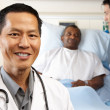 Stock Photo: Portrait Of Doctor With Patient In Background