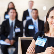 Businesswoman Delivering Presentation At Conference — ストック写真