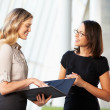 Stock Photo: Two Businesswomen Having Informal Meeting In Modern Office