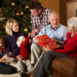 Stock Photo: Multi Generation Family Opening Christmas Presents
