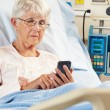 Senior Female Patient In Hospital Bed Using Mobile Phone — Stock Photo