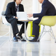 Businessmen Meeting With Laptop In Modern Office - Foto Stock