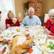 Multi Generation Family Celebrating With Christmas Meal — Stock Photo #24649871