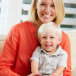 Portrait Of Mother And Son Sitting On Sofa At Home — Stock Photo