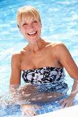 Senior Woman Having Fun In Swimming Pool — Stock Photo