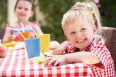 Group Of Children Enjoying Outdoor Tea Party — Stock Photo