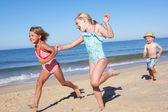 Three Children Running Along Beach — Stock Photo