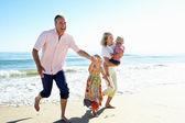 Grandparents And Grandchildren Enjoying Beach Holiday — Stock Photo