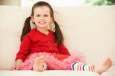 Young Girl Relaxing On Sofa At Home — Stock Photo