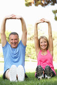 Senior Couple Exercising In Park — Photo