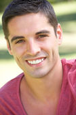 Outdoor Portrait Of Smiling Young Man — Stock Photo