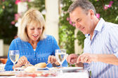 Senior Couple Enjoying Meal outdoorss — Stock Photo