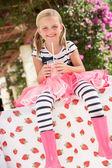Young Girl Wearing Pink Wellington Boots Drinking Milkshake — Stock Photo