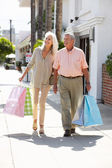 Senior Couple Carrying Shopping Bags — Stock Photo