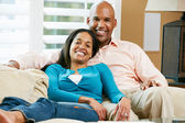 Portrait Of Couple Sitting On Sofa Together — Stock Photo