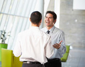 Two Businessmen Having Informal Meeting In Modern Office — Foto de Stock