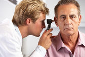 Doctor Examining Male Patient's Ears — Stock Photo