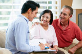 Financial Advisor Talking To Senior Couple At Home — Foto Stock
