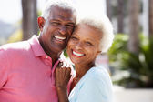 Romantic Senior Couple Hugging In Street — Stock Photo