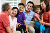 Multi Generation Family Relaxing At Home Together — Foto Stock