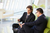 Businessmen With Digital Tablet Sitting In Modern Office — Stock Photo