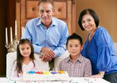 Grandparents Celebrating Children's Birthday — Stockfoto