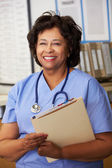Female Nurse At Nurses Station — Stock Photo