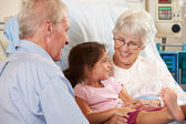 Granddaughter Visiting Grandmother In Hospital Bed — Stock Photo